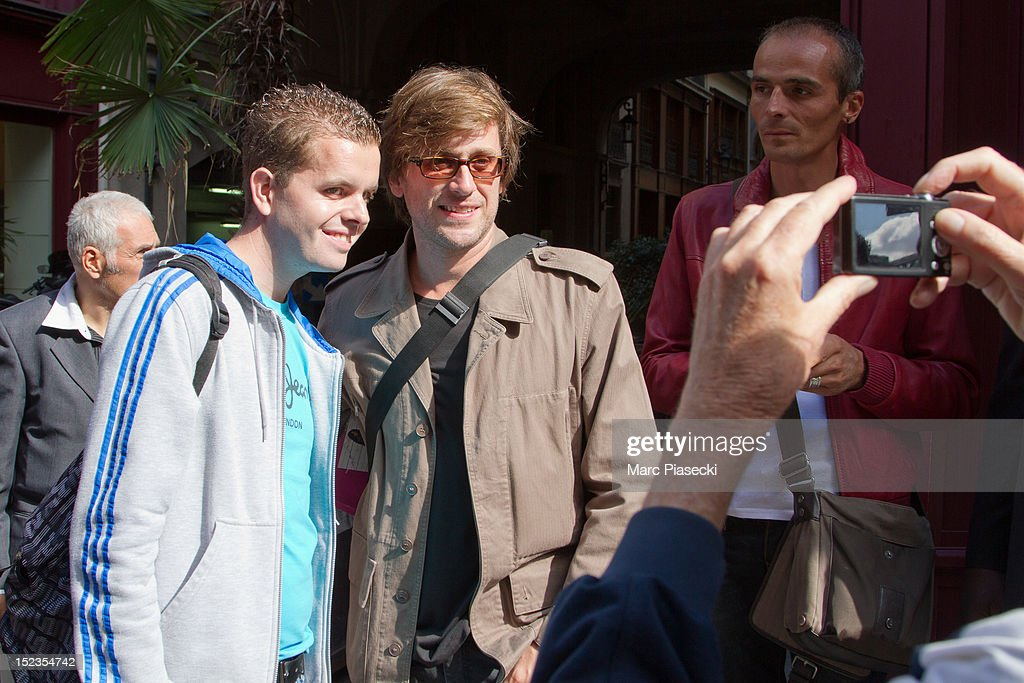 Singer Thomas Dutronc poses with fans as he arrives at L'Olympia on September 19 2012 in Paris France