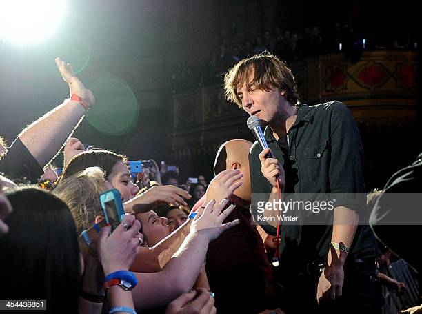 Singer Thomas Mars of Phoenix performs in the audience during The 24th Annual KROQ Almost Acoustic Christmas at The Shrine Auditorium on December 8...
