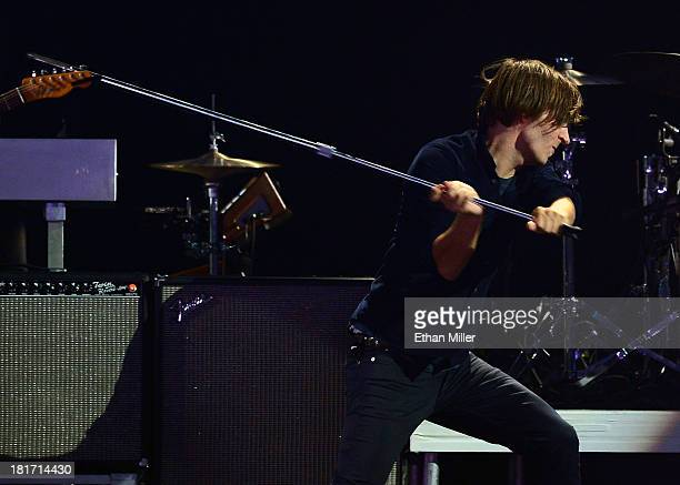 Singer Thomas Mars of the band Phoenix swings his microphone stand onstage as he performs during the iHeartRadio Music Festival at the MGM Grand...