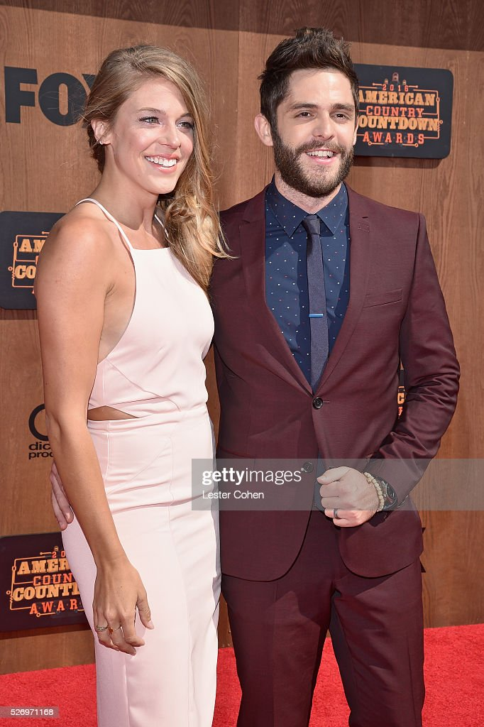 Singer Thomas Rhett (R) and guest attend the 2016 American Country Countdown Awards at The Forum on May 1, 2016 in Inglewood, California.