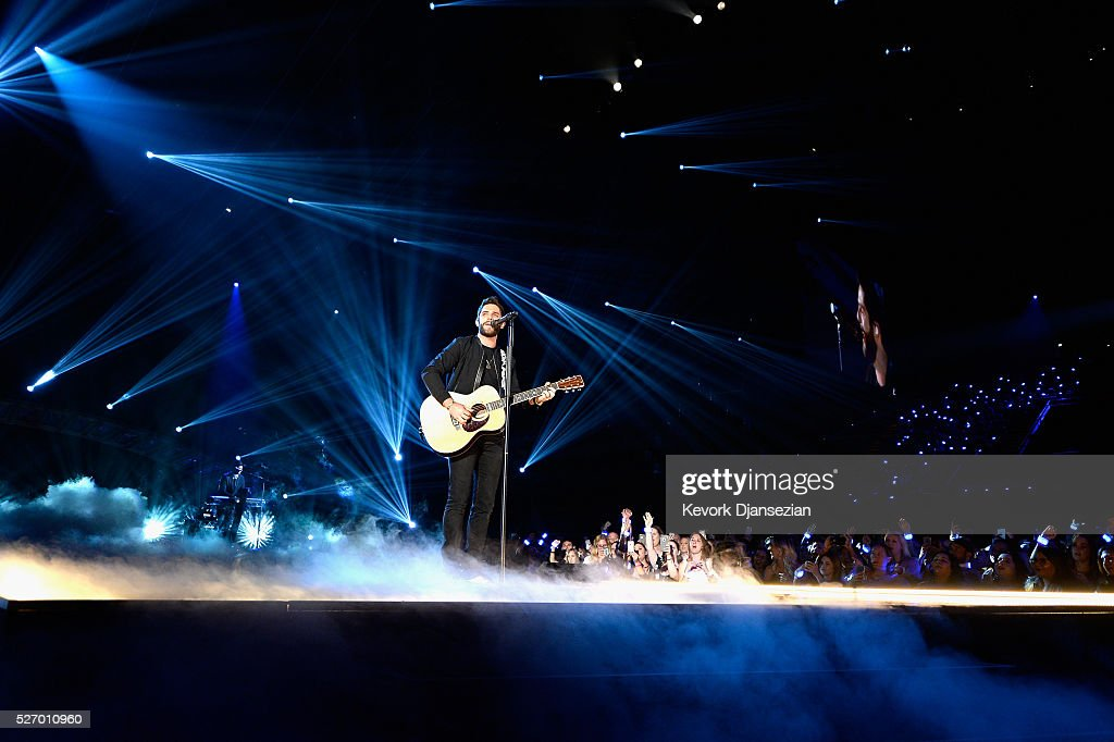 Singer Thomas Rhett performs onstage during the 2016 American Country Countdown Awards at The Forum on May 1, 2016 in Inglewood, California.