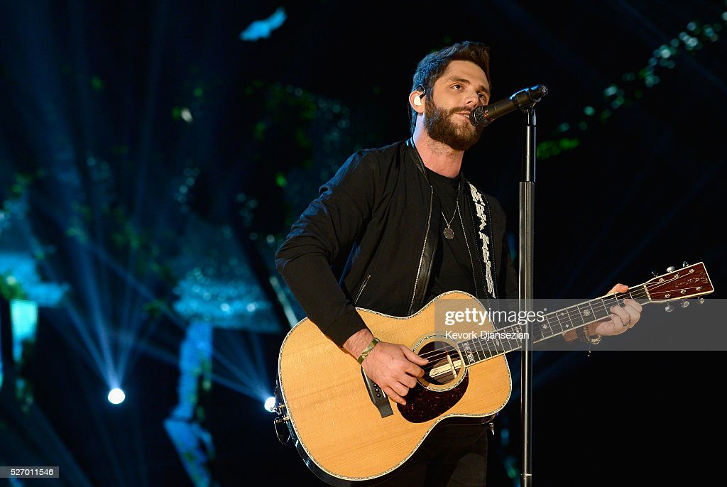 Singer <a gi-track='captionPersonalityLinkClicked' href=/galleries/search?phrase=Thomas+Rhett&family=editorial&specificpeople=9092574 ng-click='$event.stopPropagation()'>Thomas Rhett</a> performs onstage during the 2016 American Country Countdown Awards at The Forum on May 1, 2016 in Inglewood, California.
