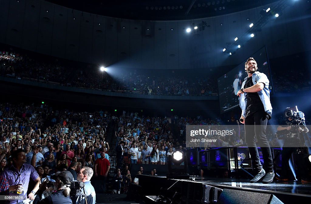 Singer <a gi-track='captionPersonalityLinkClicked' href=/galleries/search?phrase=Thomas+Rhett&family=editorial&specificpeople=9092574 ng-click='$event.stopPropagation()'>Thomas Rhett</a> performs onstage during the 2016 iHeartCountry Festival at The Frank Erwin Center on April 30, 2016 in Austin, Texas.