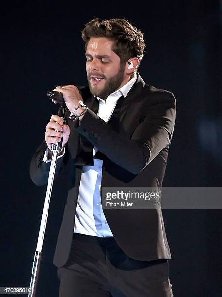 Singer Thomas Rhett performs onstage during the 50th Academy of Country Music Awards at ATT Stadium on April 19 2015 in Arlington Texas