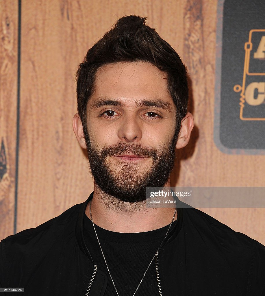Singer Thomas Rhett poses in the press room at the 2016 American Country Countdown Awards at The Forum on May 01, 2016 in Inglewood, California.