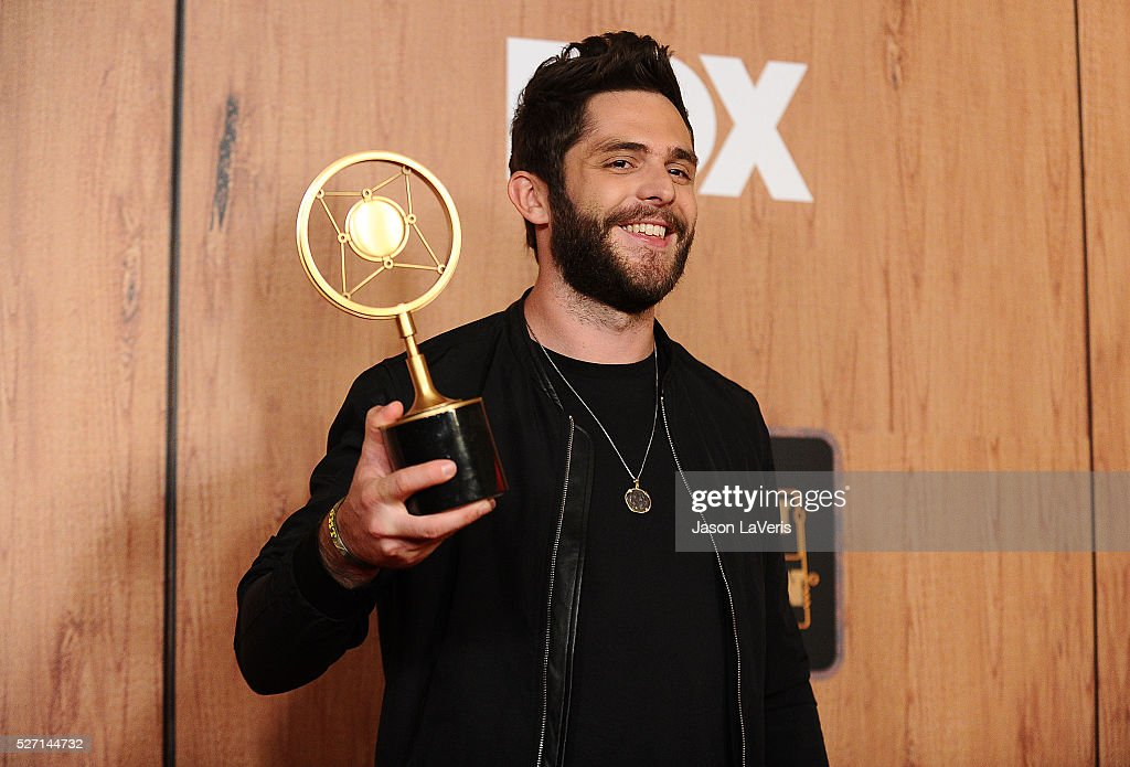 Singer <a gi-track='captionPersonalityLinkClicked' href=/galleries/search?phrase=Thomas+Rhett&family=editorial&specificpeople=9092574 ng-click='$event.stopPropagation()'>Thomas Rhett</a> poses in the press room at the 2016 American Country Countdown Awards at The Forum on May 01, 2016 in Inglewood, California.
