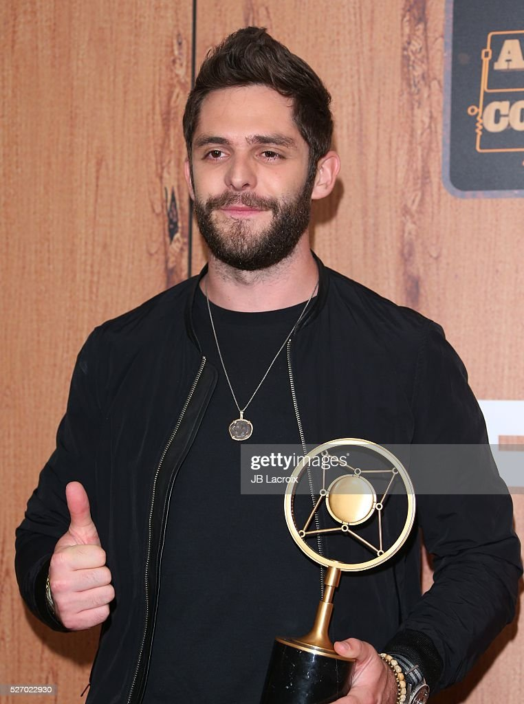 Singer <a gi-track='captionPersonalityLinkClicked' href=/galleries/search?phrase=Thomas+Rhett&family=editorial&specificpeople=9092574 ng-click='$event.stopPropagation()'>Thomas Rhett</a> poses in the press room during the 2016 American Country Countdown Awards at The Forum on May 1, 2016 in Inglewood, California.