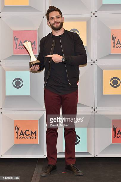 Singer Thomas Rhett winner of Single Record of the Year for 'Die a Happy Man' poses in the press room during the 51st Academy of Country Music Awards...