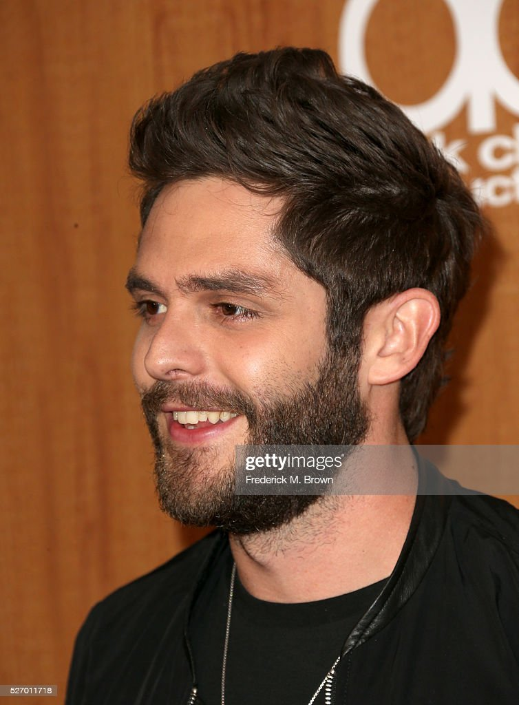 Singer <a gi-track='captionPersonalityLinkClicked' href=/galleries/search?phrase=Thomas+Rhett&family=editorial&specificpeople=9092574 ng-click='$event.stopPropagation()'>Thomas Rhett</a> winner of the award for 'Song of the Year,' poses in the press room during the 2016 American Country Countdown Awards at The Forum on May 1, 2016 in Inglewood, California.