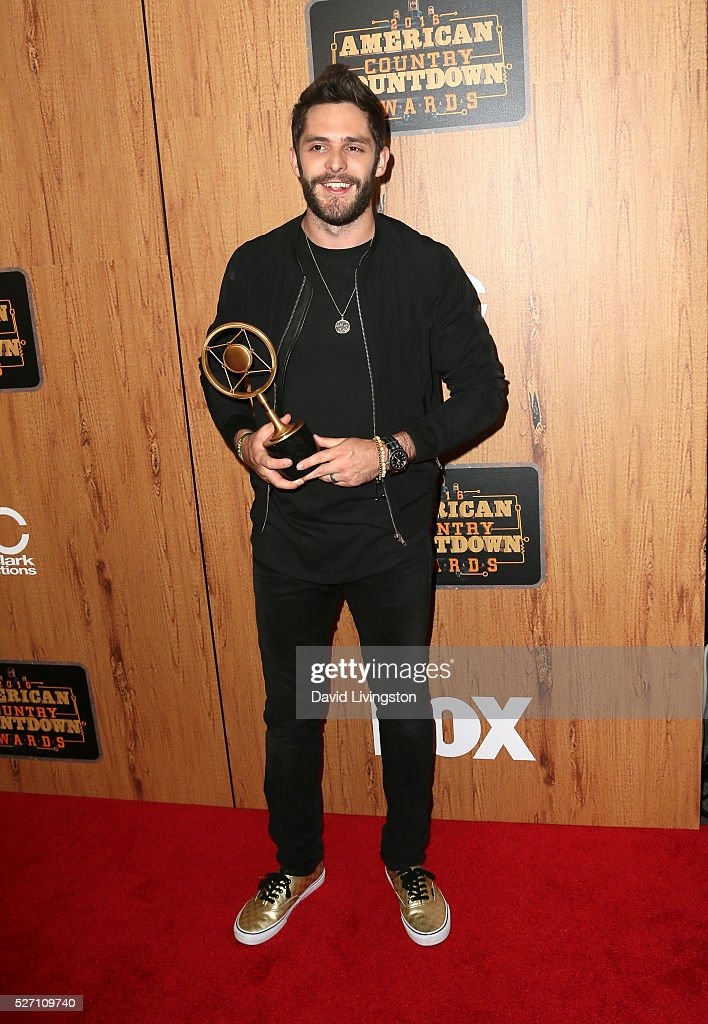 Singer <a gi-track='captionPersonalityLinkClicked' href=/galleries/search?phrase=Thomas+Rhett&family=editorial&specificpeople=9092574 ng-click='$event.stopPropagation()'>Thomas Rhett</a> winner of the award for 'Song of the Year,' poses in the press room at the 2016 American Country Countdown Awards at The Forum on May 01, 2016 in Inglewood, California.