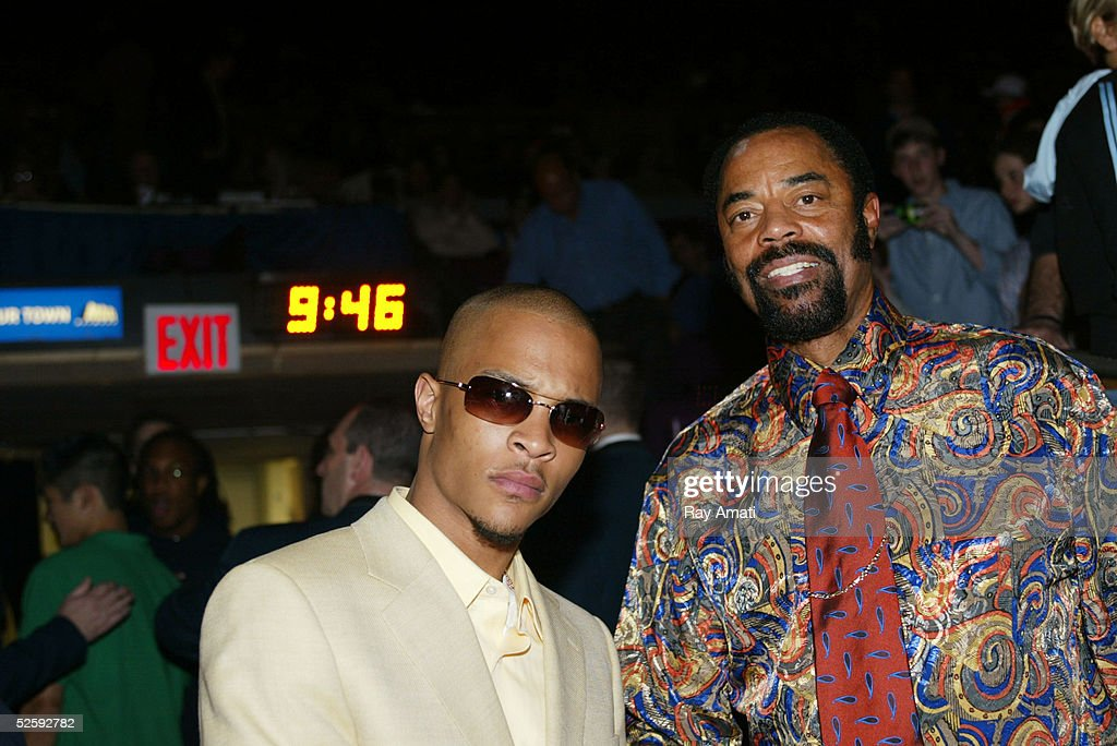 R&B singer T.I. poses with Knicks' legend Walt Frazier courtside at the Indiana Pacers v New York Knicks NBA game at Madison Square Garden April 5, 2005 in New York City.