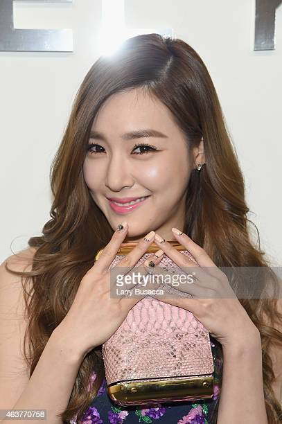 Singer Tiffany Hwang poses backstage at the Michael Kors fashion show during MercedesBenz Fashion Week Fall 2015 at Spring Studios on February 18...