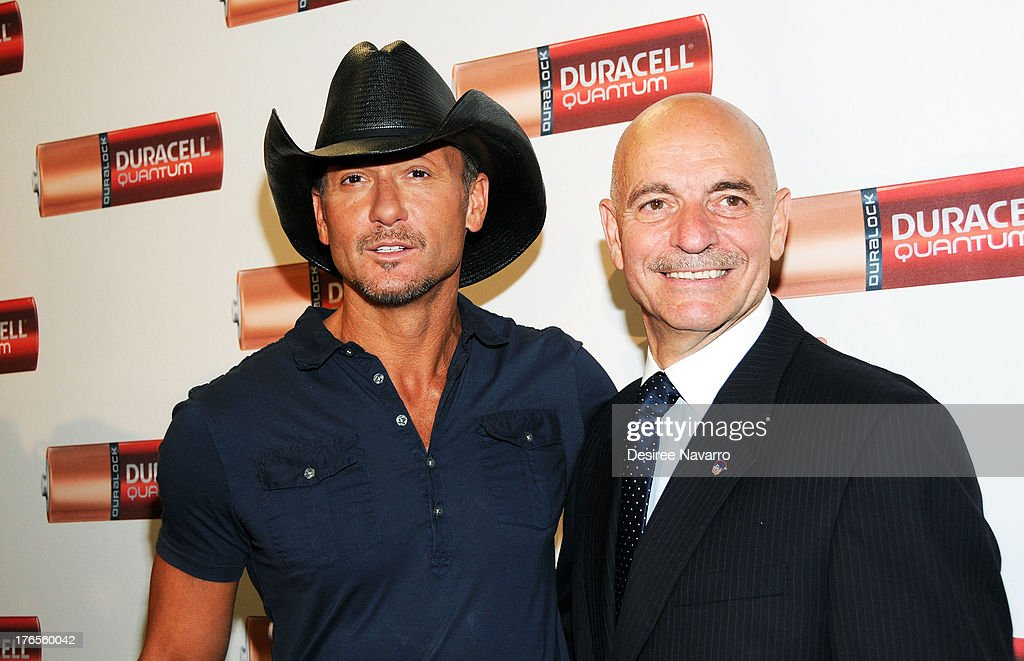 Singer <a gi-track='captionPersonalityLinkClicked' href=/galleries/search?phrase=Tim+McGraw&family=editorial&specificpeople=202845 ng-click='$event.stopPropagation()'>Tim McGraw</a> (L) and New York City Fire Commissioner Salvatore J. Cassano attend the 'Quantum Heroes' premiere at Engine 33, Ladder 9 on August 15, 2013 in New York City.