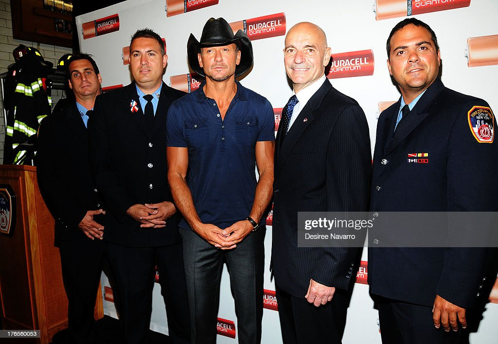 Singer <a gi-track='captionPersonalityLinkClicked' href=/galleries/search?phrase=Tim+McGraw&family=editorial&specificpeople=202845 ng-click='$event.stopPropagation()'>Tim McGraw</a> (C) and New York City Fire Commissioner Salvatore J. Cassano (2nd R) attend the 'Quantum Heroes' premiere at Engine 33, Ladder 9 on August 15, 2013 in New York City.