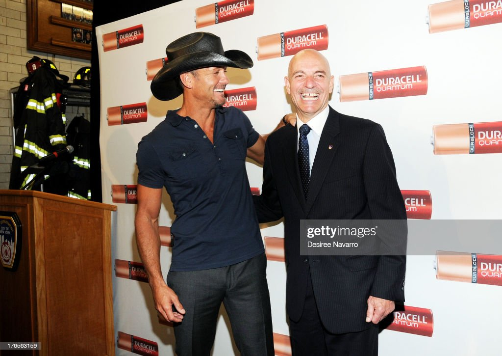 Singer Tim McGraw (L) and New York City Fire Commissioner Salvatore J. Cassano attend the 'Quantum Heroes' premiere at Engine 33, Ladder 9 on August 15, 2013 in New York City.
