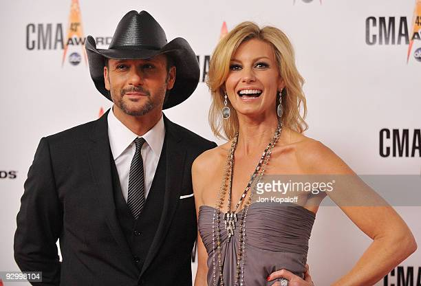 Singer Tim McGraw and wife singer Faith Hill arrive at the 43rd Annual CMA Awards at the Sommet Center on November 11 2009 in Nashville Tennessee