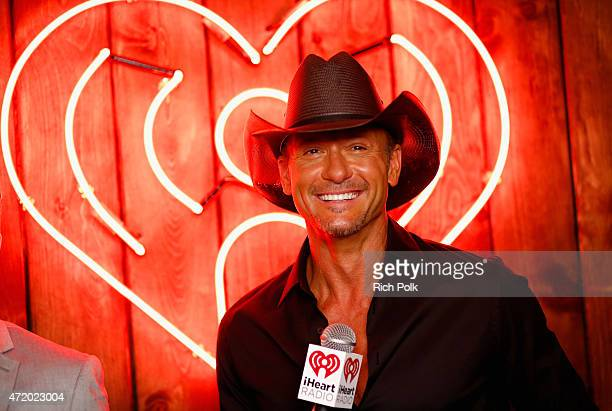 Singer Tim McGraw poses backstage during the 2015 iHeartRadio Country Festival at The Frank Erwin Center on May 2 2015 in Austin Texas The 2015...