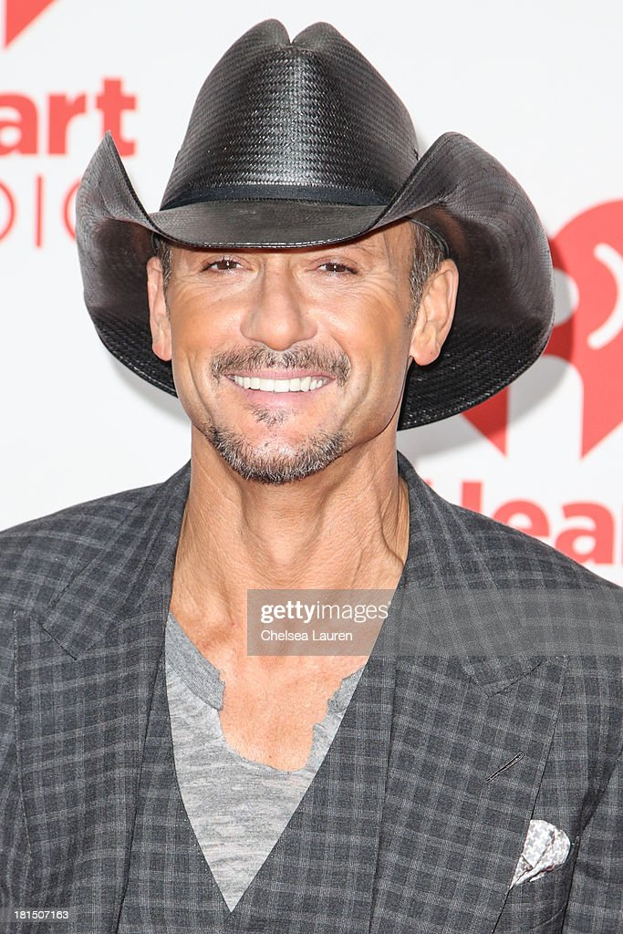 Singer <a gi-track='captionPersonalityLinkClicked' href=/galleries/search?phrase=Tim+McGraw&family=editorial&specificpeople=202845 ng-click='$event.stopPropagation()'>Tim McGraw</a> poses in the iHeartRadio music festival photo room on September 21, 2013 in Las Vegas, Nevada.