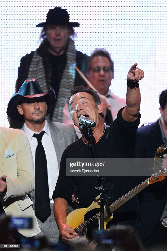 Singer <a gi-track='captionPersonalityLinkClicked' href=/galleries/search?phrase=Tim+McGraw&family=editorial&specificpeople=202845 ng-click='$event.stopPropagation()'>Tim McGraw</a>, singer <a gi-track='captionPersonalityLinkClicked' href=/galleries/search?phrase=Neil+Young&family=editorial&specificpeople=209195 ng-click='$event.stopPropagation()'>Neil Young</a>, honoree <a gi-track='captionPersonalityLinkClicked' href=/galleries/search?phrase=Bruce+Springsteen&family=editorial&specificpeople=123832 ng-click='$event.stopPropagation()'>Bruce Springsteen</a> and drummer <a gi-track='captionPersonalityLinkClicked' href=/galleries/search?phrase=Max+Weinberg&family=editorial&specificpeople=1059983 ng-click='$event.stopPropagation()'>Max Weinberg</a> perform onstage at The 2013 MusiCares Person Of The Year Gala Honoring <a gi-track='captionPersonalityLinkClicked' href=/galleries/search?phrase=Bruce+Springsteen&family=editorial&specificpeople=123832 ng-click='$event.stopPropagation()'>Bruce Springsteen</a> at Los Angeles Convention Center on February 8, 2013 in Los Angeles, California.