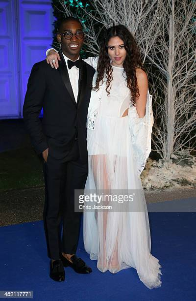 Singer Tinie Tempah and Eliza Doolittle arrive at Kensington Palace for the Centrepoint Winter Whites Gala on November 26 2013 in London England