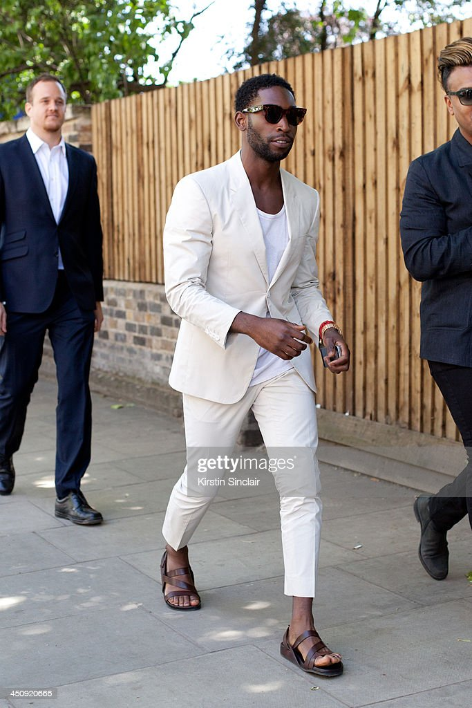 Singer <a gi-track='captionPersonalityLinkClicked' href=/galleries/search?phrase=Tinie+Tempah&family=editorial&specificpeople=6742538 ng-click='$event.stopPropagation()'>Tinie Tempah</a> on day 3 of London Collections: Men on June 17, 2014 in London, England.