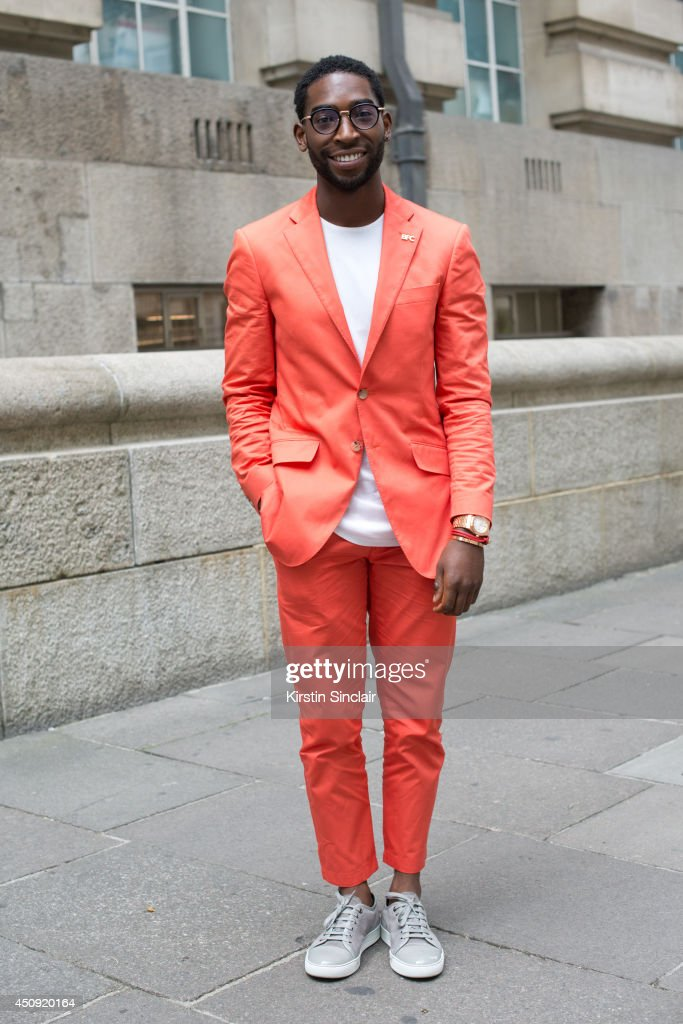 Singer <a gi-track='captionPersonalityLinkClicked' href=/galleries/search?phrase=Tinie+Tempah&family=editorial&specificpeople=6742538 ng-click='$event.stopPropagation()'>Tinie Tempah</a> wears a Richard James suit on day 2 of London Collections: Men on June 16, 2014 in London, England.