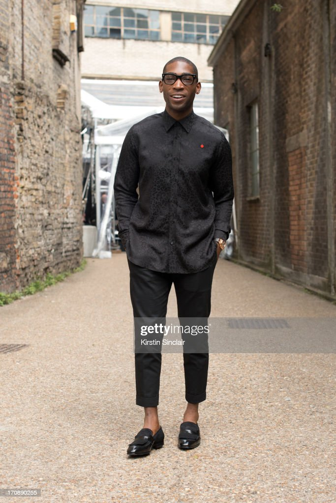 Singer <a gi-track='captionPersonalityLinkClicked' href=/galleries/search?phrase=Tinie+Tempah&family=editorial&specificpeople=6742538 ng-click='$event.stopPropagation()'>Tinie Tempah</a> wears an Yves Saint Laurent top and Dolce Gabbana trousers on day 2 of London Collections: Men on June 17, 2013 in London, England.