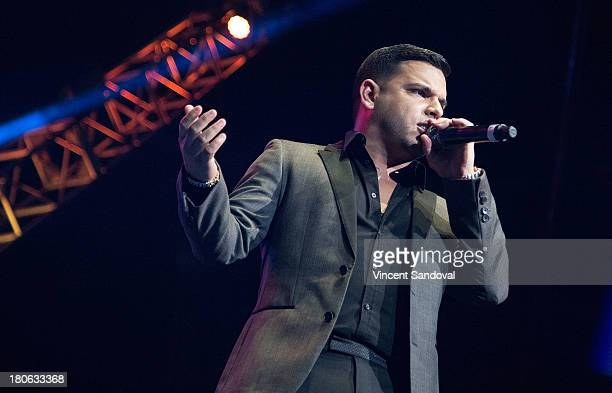 Singer Tito 'El Bambino' performs at the Latino 963 FM's Calibash 2013 at Staples Center on September 14 2013 in Los Angeles California