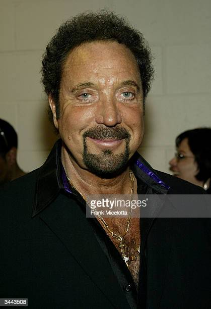 Singer Tom Jones poses backstage at the 7th Annual VH1 'Divas' Concert Benefiting The Save The Music Foundation at the MGM Grand Garden Arena April...