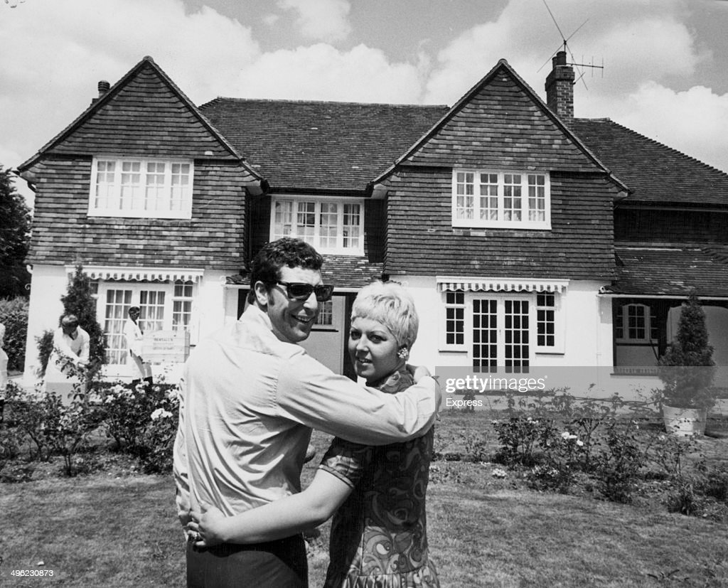 Singer Tom Jones with his wife Linda, posing outside their home in Glamorgan, Wales, July 20th 1967.