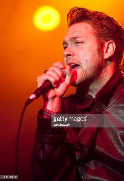 Singer Tom Meighan of the British rock band Kasabian performs live during a concert at the Huxleys Neue Welt on November 2 2009 in Berlin Germany The...