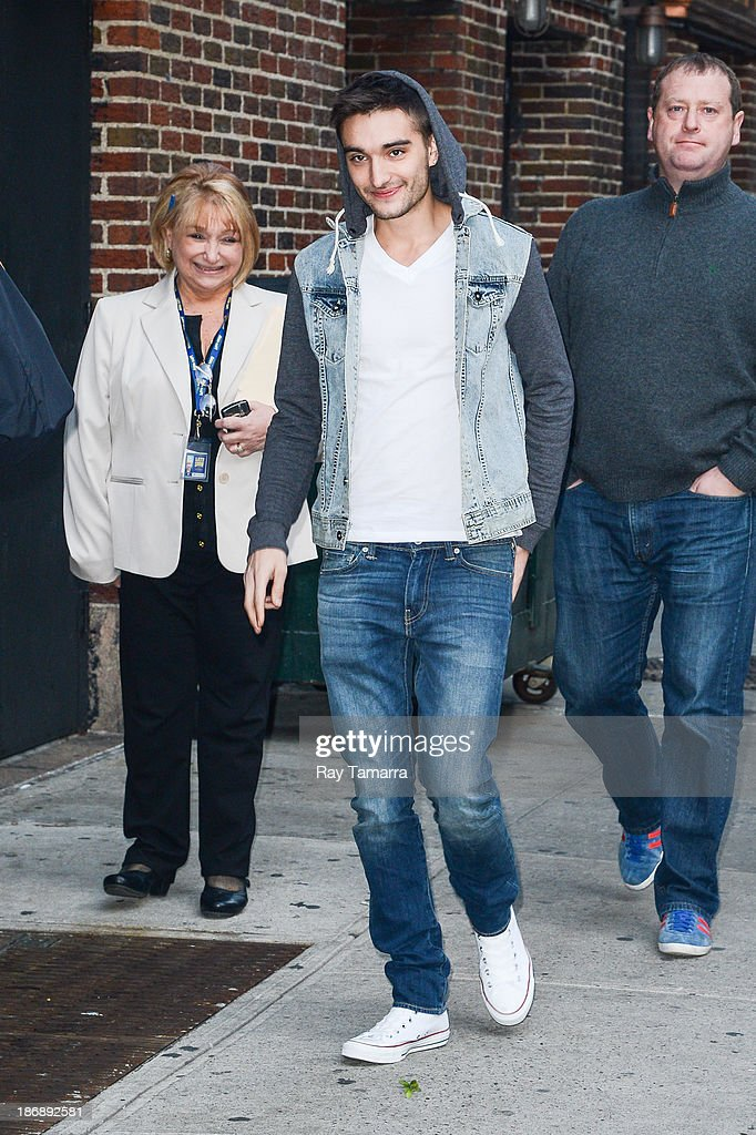 Singer Tom Parker of The Wanted enters the 'Late Show With David Letterman' at the Ed Sullivan Theater on November 4, 2013 in New York City.
