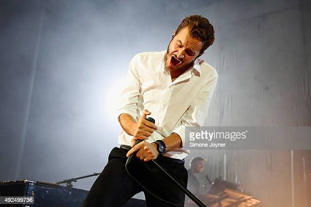 Singer Tom Smith of Editors performs live on stage at Eventim Apollo on October 13 2015 in London England