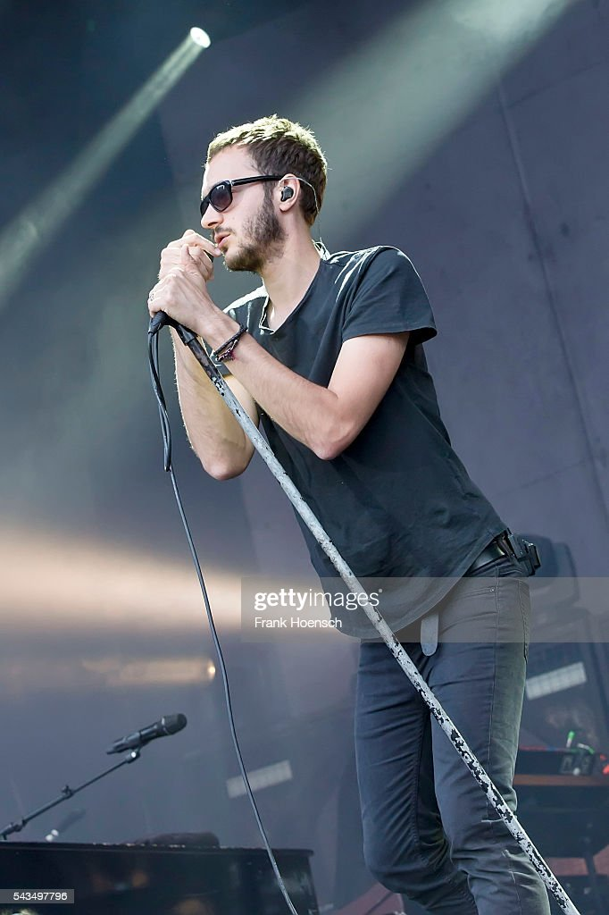 Singer Tom Smith of the British band Editors performs live during a concert at the Zitadelle Spandau on June 28, 2016 in Berlin, Germany.
