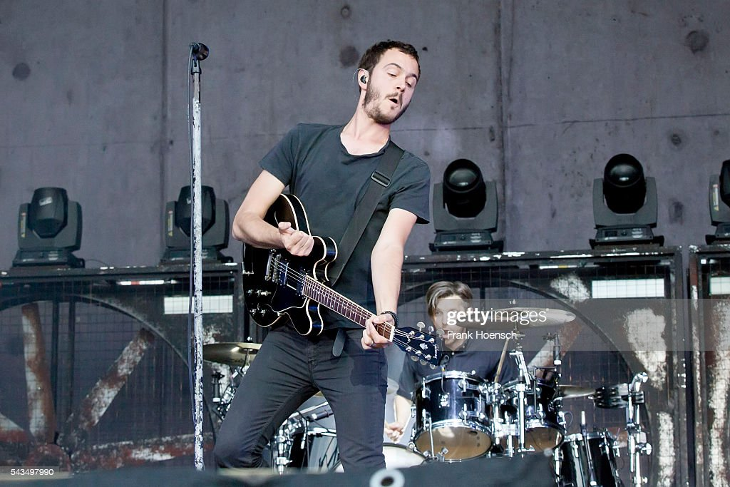 Singer <a gi-track='captionPersonalityLinkClicked' href=/galleries/search?phrase=Tom+Smith+-+Musician&family=editorial&specificpeople=4175187 ng-click='$event.stopPropagation()'>Tom Smith</a> of the British band Editors performs live during a concert at the Zitadelle Spandau on June 28, 2016 in Berlin, Germany.