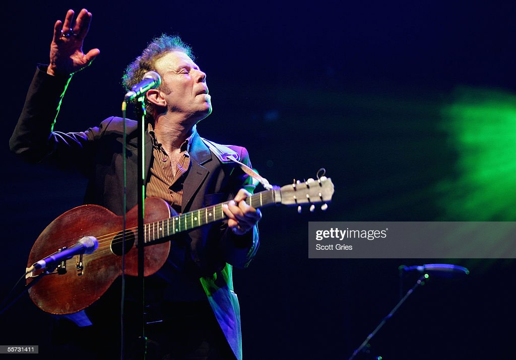 Singer Tom Waits performs on stage at the 'From the Big Apple to the Big Easy' New York City's Benefit Concert for the Gulf Coast at Radio City Music Hall September 20, 2005 in New York City.