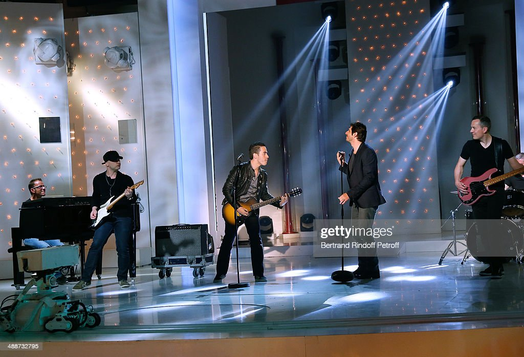 Singer Tomi and main guest of the show singer Pattrick Fiori perform at the 'Vivement Dimanche' French TV Show, held at Pavillon Gabriel on May 14, 2014 in Paris, France.