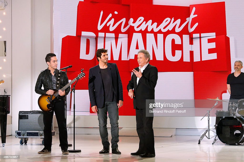 Singer Tomi, main guest of the show singer Patrick Fiori and presenter of the show Michel Drucker at the 'Vivement Dimanche' French TV Show, held at Pavillon Gabriel on May 14, 2014 in Paris, France.