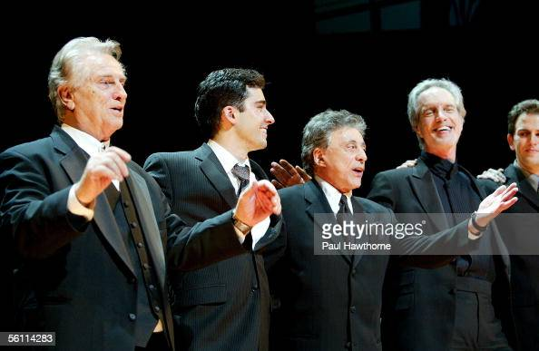 Singer Tommy DeVito actor John Lloyd Young singers Frankie Valli and Bob Gaudio of Frankie Valli and the Four Seasons onstage during the curtain call...