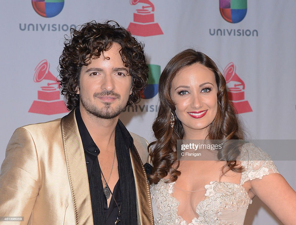 Singer Tommy Torres (L) and model Karla Monroig pose backstage during The 14th Annual Latin GRAMMY Awards at the Mandalay Bay Events Center on November 21, 2013 in Las Vegas, Nevada.