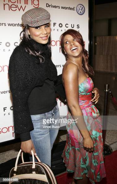 Singer Toni Braxton and sister Tamar attend the premiere of Focus Features' romantic comedy 'Something New' at the Cinerama Dome on January 24 2006...