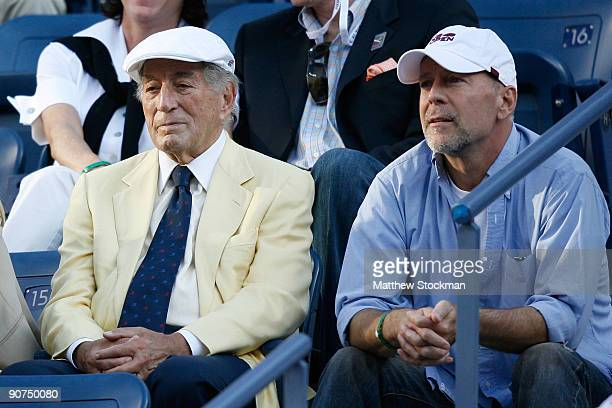 Singer Tony Bennett and actor Bruce Willis watch the match between Roger Federer of Switzerland and Juan Martin Del Potro of Argentina on day fifteen...