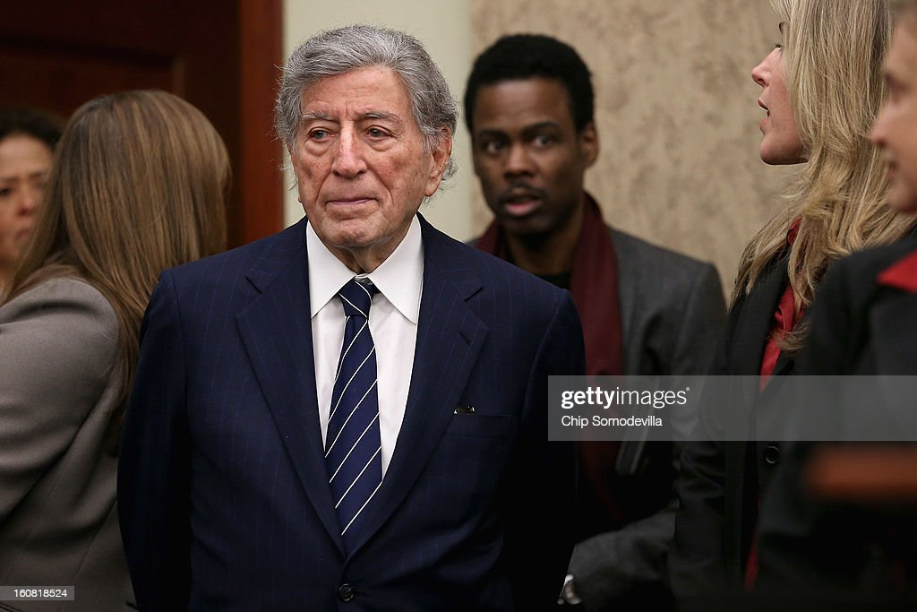 Singer Tony Bennett and actor Chris Rock arrive for a news conference hosted by Mayors Against Illegal Guns Director and the Law Center to Prevent Gun Violence at the U.S. Capitol February 6, 2013 in Washington, DC. The artists, activists and politicians called for manditory background check on all gun purchases among other restrictions.