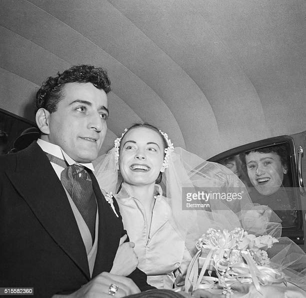 Singer Tony Bennett and his bride Patricia Beech leaving St Patrick's Cathedral in their wedding car on February 12 1952 after marrying A fan peers...