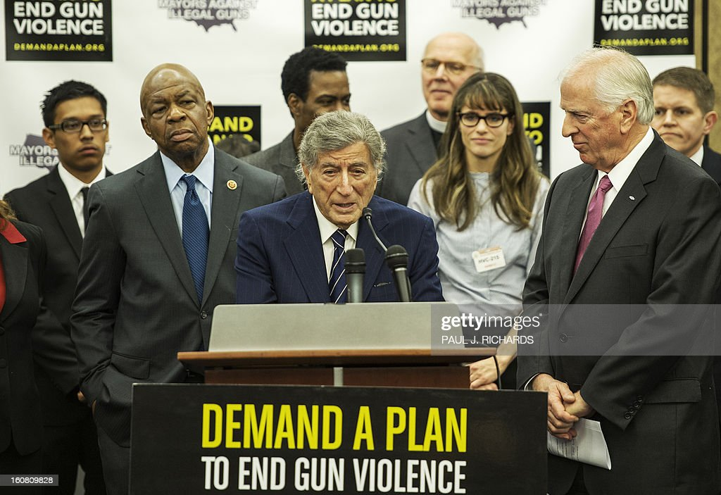 US singer Tony Bennett delivers brief remarks during a press conference by Mayors Against Illegal Guns February 6, 2013 on Capitol Hill in Washington, DC as US Rep Elijah Cummings(D-MD), Entertainer Chris Rock(C behind), Rev Timothy A. Boggs(R), and Actress Amanda Peet(2ndR) look on from the rear. The group of various mayors, victims, entertainers, and political leaders, called for common sense proposals for gun violence prevention. AFP PHOTO/Paul J. Richards
