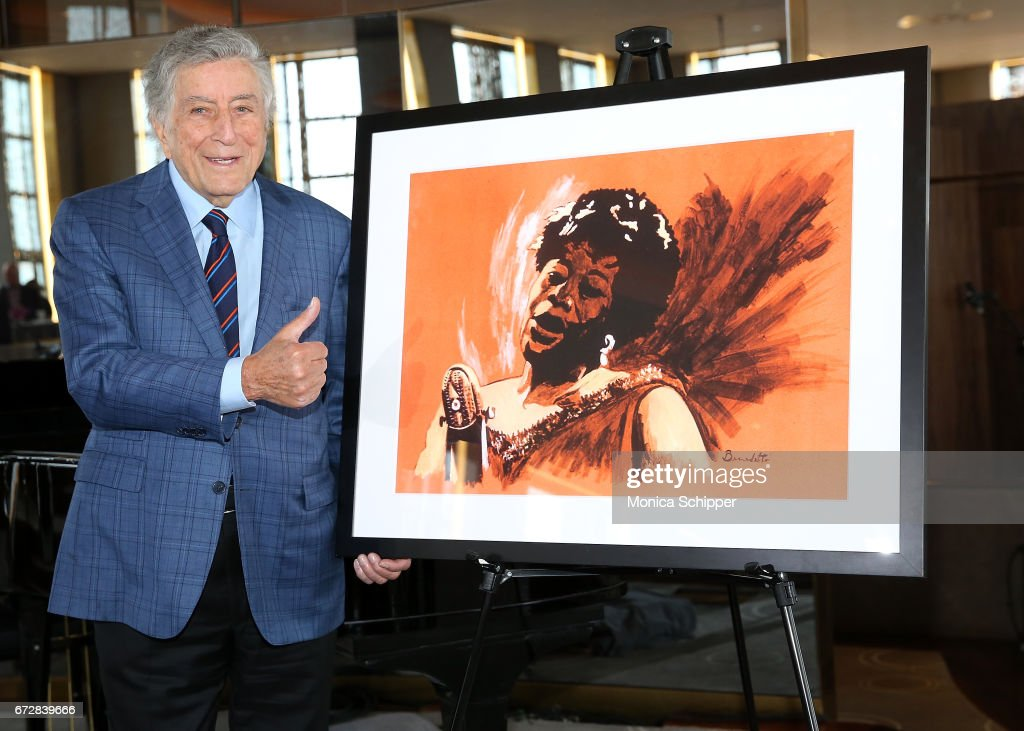 Singer Tony Bennett poses for a photo with one of his paintings at the Ella Fitzgerald's 100th Birthday Celebration & Ella Fitzgerald Day Proclamation at The Rainbow Room on April 25, 2017 in New York City.