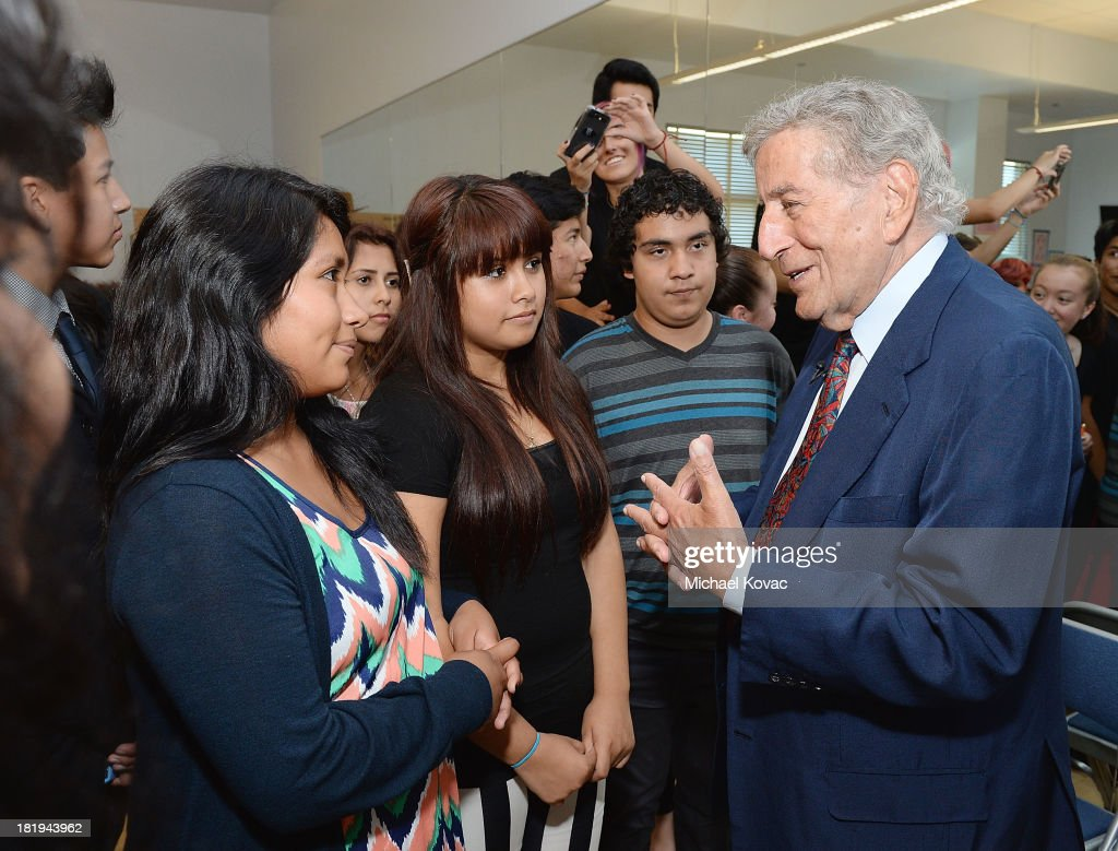 Singer <a gi-track='captionPersonalityLinkClicked' href=/galleries/search?phrase=Tony+Bennett+-+Singer&family=editorial&specificpeople=160951 ng-click='$event.stopPropagation()'>Tony Bennett</a> (R) speaks with students during a campus visit to celebrate the expansion of Exploring the Arts within three high schools on the Esteban E. Torres High School Campus on September 26, 2013 in Los Angeles, California.