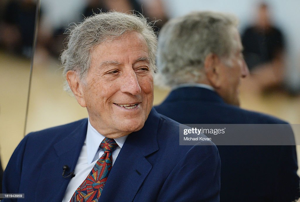 Singer <a gi-track='captionPersonalityLinkClicked' href=/galleries/search?phrase=Tony+Bennett+-+Singer&family=editorial&specificpeople=160951 ng-click='$event.stopPropagation()'>Tony Bennett</a> tours the campus of Esteban E. Torres High School in support of the L.A. expansion of NYC based non-profit organization, Exploring the Arts, on September 26, 2013 in Los Angeles, California.