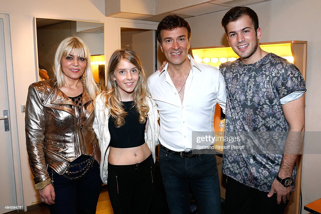 Singer <a gi-track='captionPersonalityLinkClicked' href=/galleries/search?phrase=Tony+Carreira&family=editorial&specificpeople=7880389 ng-click='$event.stopPropagation()'>Tony Carreira</a> (2nd R) poses with his wife Fernanda Antunes (L), his daughter Sara (2nd L) and his son David (R) after his concert at Palais des Sports on April 12, 2014 in Paris, France.