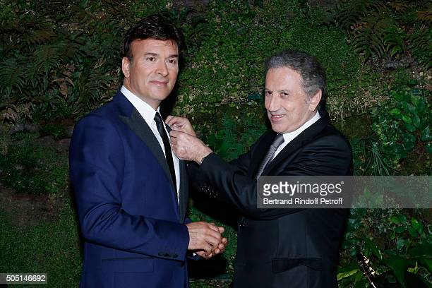 Singer Tony Carreira receives the 'Medal of Chevalier of Arts and Letters' from Michel Drucker's hands Held at Hotel de Sers on January 15 2016 in...